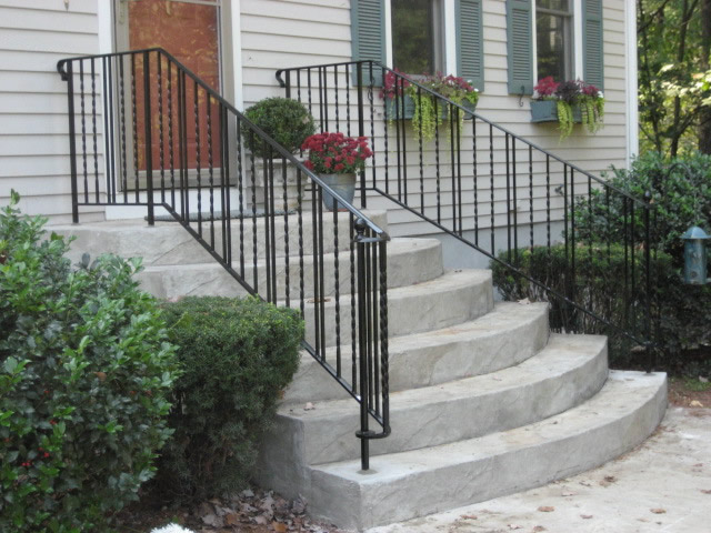 Colonial iron works iron exterior handrails for Curved metal railings exterior